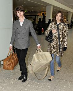 Alexa Chung Photos - Arctic Monkey's Alex Turner and girlfriend Alexa Chung are pictured flying into Heathrow airport from Los Angeles. - Alex Turner And Alexa Chung Arriving At Heathrow Airport