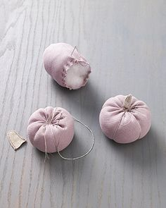 Easy Fabric Pumpkins from Martha Stewart.  Instructions are for decorative use, but they'd be perfectly cute pin cushions too.