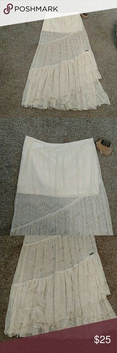 NWT: Billabong boho long flowy lace skirt: Brand new with tags. Off white Billabong boho style full length lace skirt. Has short slip underneath. Size large but could fit a medium also. Offers welcome!! Billabong Dresses Maxi