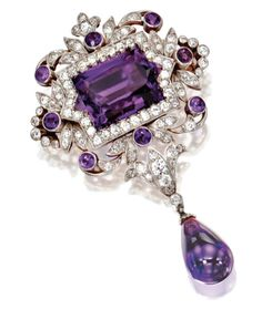GOLD, PLATINUM, AMETHYST AND DIAMOND TIFFANY & CO. PENDANT-BROOCH CIRCA 1900.  The central stone is a fancy rectangular star-cut amethyst. Sotheby's.