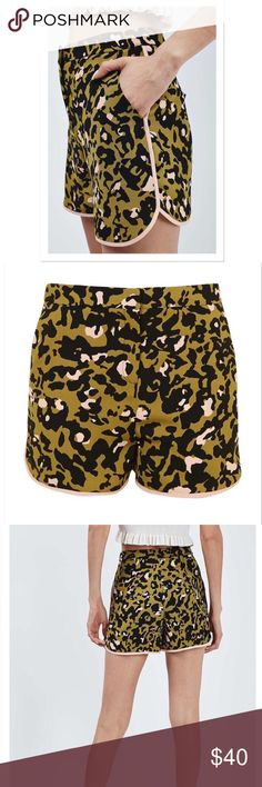 Topshop Runner Shorts Animal print runner shorts by Topshop. Lightweight. High-rise waist w/clean front-zip closure and hook-and-bar closure. Side slant pockets. Topshop Shorts