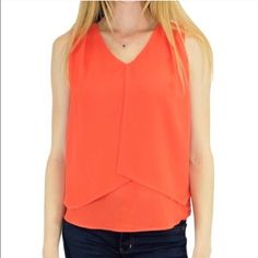 Sleeveless Gigi Top by Relished Trapeze blouse that is undoubtedly a statement piece and flattering for every body shape. This top captures sophistication and a hint of cool casualness.  100% Polyester Relished Tops