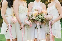 protea bouquets and lush full brides bouquet
