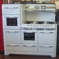 1940s OKeefe & Merritt Bel Air Estate Range  Has it all!!  2 ovens, 2 broilers, bread and plate warmer over upper oven, six burners, chrome shelf, storage drawers on bottom.  56 1/2 Inches Wide.