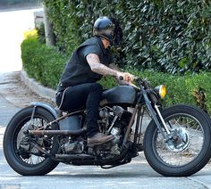Biker chic: David looked effortlessly cool in his black denim separates as he rode around ...