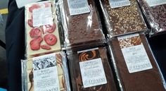 A selection of our artisan chocolate bars, including the ever popular Salted Caramel Bar - available in our online boutique http://eponinepatisserie.co.uk/product/salted-caramel-swirled-dark-milk-chocolate-bar/ (Photograph taken by Wallasey Food Fair) (Eponine Patisserie & Chocolaterie)