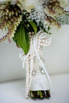 Who would of thought of pearls wrapped around the bridal bouquet?!.... splendid!