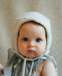 Knitted Purl bee baby bonnet by tami, look at the eyes!!!  Sooo cute!