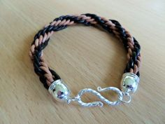 Leather kumihimo bracelet by CoastalMoonJewellery on Etsy