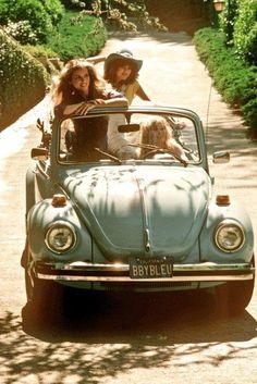 Hippie chicks in a Bug