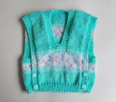 Ravelry: Melika self-patterning yarn baby vest top pattern by marianna mel