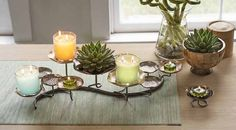 Introducing the new Lotus collection. Shimmering lotus flowers are a touch of fantasy for your table. Silver, gold and copper-colored petals glisten underneath jar candles and tealights. Multiple heights add drama and dimension.