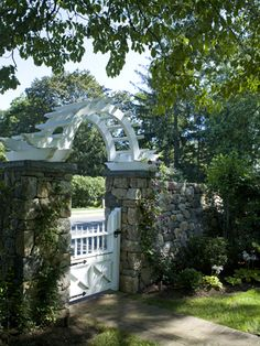 Love this stone work, gate and arch in Fairfield, CT from the portfolio of Mark P. Finlay Architects. Photo by Larry Lambrecht