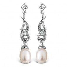 Rhapsody Diamond, Pearl  CZ Earrings  These simple yet elegant Rhapsody dropper earrings are set with 2 sparkling diamonds, luxurious teardrop shaped hint of cream coloured cultured pearls and cubic zirconias. The clean lines of this design mean that the most ornate dresses now have jewellery which balance your look. Wear with its matching pendant and wow! Lavishly coated in rhodium and beautifully boxed. Total drop length 35mm*.  *all measurements are approximate