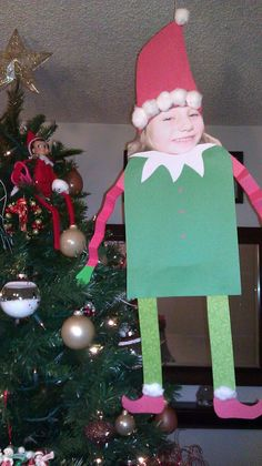Getting Elfed. An 8X10 picture construction paper, glue and cotton balls..
