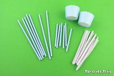 Swing set construction materials: paper straws, pipe cleaners and cupcake liners