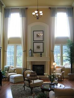 window treatments for two story family room...also love the fireplace