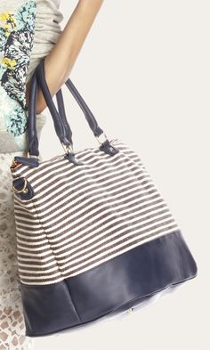 bff433a486c3 Blue   white striped soft canvas duffle bag with a removable shoulder strap  and bottom feet