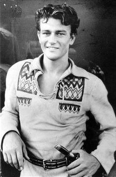 John Wayne, 1930. 23 years old here.  What a handsome guy,  and a  lucky photo find!