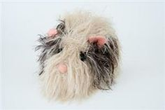 Knitted guinea pig. I haven't seen a guinea pig before. I think this is so cute!! What say you, Sonja??