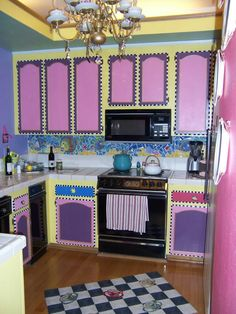 Alice In Wonderland Kitchen Photo: This Kitchen Has Painted Cabinets, A  Back Splash Mozaic From Broken Plates, Silverware, Shells.