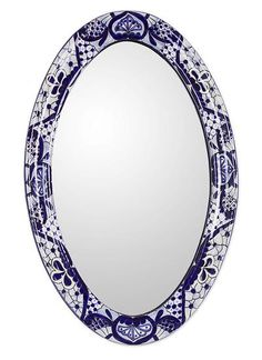 Hand-painted Ceramic Mirror Frame, 'Cobalt Fantasy'   Leonardo Godínez evokes the uniqueness of Talavera artistry with the design of this mirror frame. He paints the ceramic frame by hand in cobalt blue over white with exquisite detail.