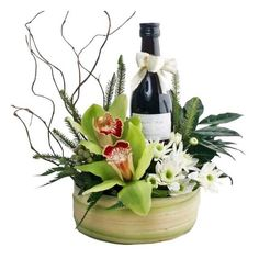 Cymbidium Orchids & Red Wine Arrangement in A Plastic Container Covered Wi. - Cymbidium Orchids & Red Wine Arrangement in A Plastic Container Covered With Coconut Leaves. Flowers For Men, Flowers Wine, Paper Flowers, Coconut Leaves, Wine Gift Baskets, Cymbidium Orchids, Deco Floral, Wine Bottle Crafts, Wine Gifts