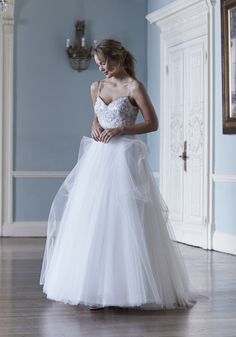 This demure Lucianna design by Sassi Holford is hand made in England. Definitely one for a bride set to be the belle of the ball. We love the simple styling and ballerina-esque detailed bodice.   sassiholford.com