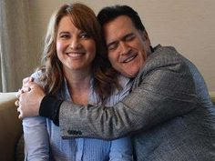 Bruce Campbell gives Lucy Lawless a hug during their interview