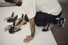 Jay Howell sketching in Sk8-Hi's.