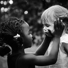 No worry...It's gona' be ok...heart warming photography of African American girl and little white girl looking eye to eye. They are precious.