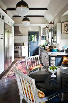 Sweet country kitchen...would want dark hardwood floors instead!
