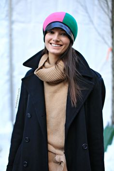 Ava Smith after DKNY, New York, February 2013 doing the color blocking  hat thing.