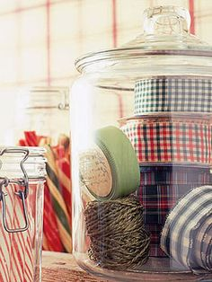 Candy and Ribbon Jars    Put spools of ribbon and colorful peppermint sticks in jars for a useful and cheery display.