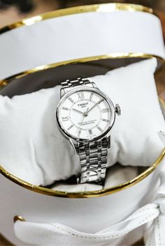 The Tissot Chemin Des Tourelles Powermatic 80 Ladies watch is a luxurious classic timepiece that stands out on the wrist due to the detailing of the watch and the contrast materials giving it charm and sophistication.