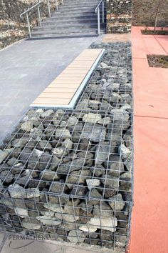 A Gabion Wall used as a bench in a garden setting Garden