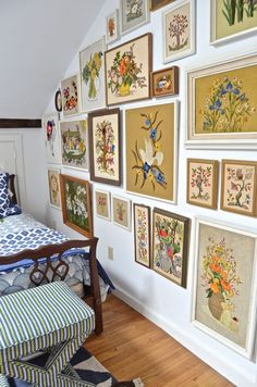 Guest bedroom with mixed patterns and textures. Gallery wall of embroidered art.