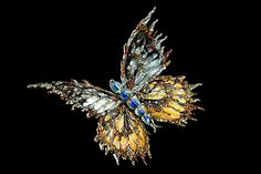 Opal, crystal and fancy coloured diamonds have been used to create this unbelievable brooch by Wallace Chan.