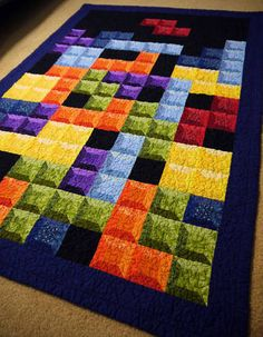 """""""The 3-D shadow effect is achieved by using 5 different fabrics per block -- all of one color, but varying shades. The lady at the cutting counter must have thought I was nuts when I showed up with 35 different fabrics, asking for 1/4 yard cut of each!"""""""