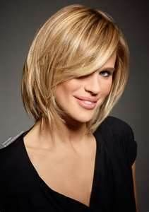 Medium length haircut with a textured cutting line and layers