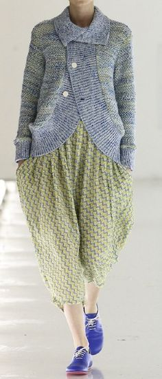 Tweeded or marled yarn used in this cardigan plus the fact that it has a collar as most of this style do not