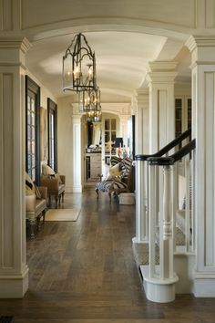 My dream hallways...generous proportions with beautiful lantern style fixtures. Love the windows and all the gorgeous wood paneling!