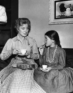 Greer Garson and Donna Corcoran enjoy a break on the set of Scandal at Scourie