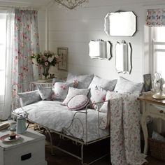 Shabby Chic style living room with iron daybed and vintage mirrors.