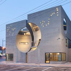 Concave facades on twin buildings create moon-shaped indents