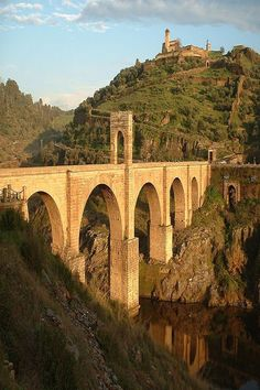 At the Alcántara Bridge in Spain.