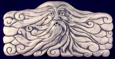 Decorative handmade ceramic tile: Decorative, relief carved ceramic wind man