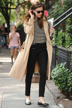 Parisian chic ~ skinny jeans and stripes with a classic trench coat.