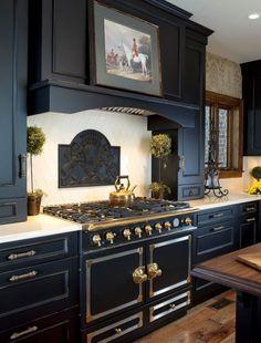 Stunning dark kitchen inspired by vintage Parisian style