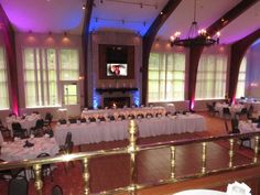 Lindsey and Eric chose uplighting in both purple and blue at their reception at Peek'n Peak Resort & Spa in the Retreat on September 12, 2014.